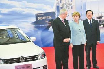 默克尔试乘成都造新捷达 愿加强新能源汽车合作