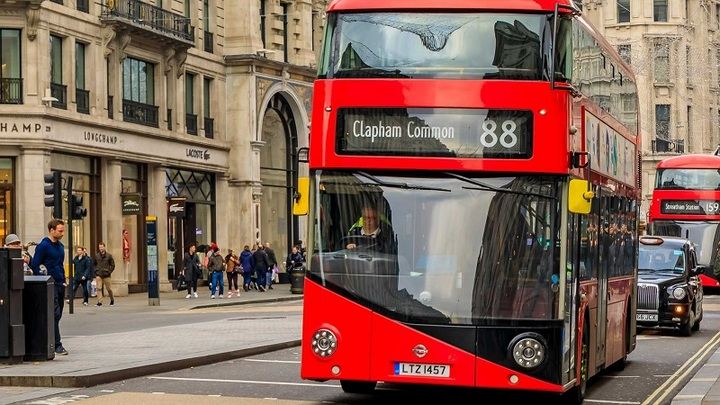 regent-street-with-people-passing-by-and-a-double-decker-red-bus.jpg