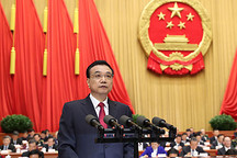 李克强总理政府工作报告:继续执行新能源汽车购置优惠政策