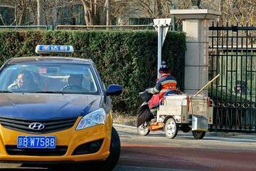 """明年底北京超2成出租车""""油改电"""",如何定价?"""